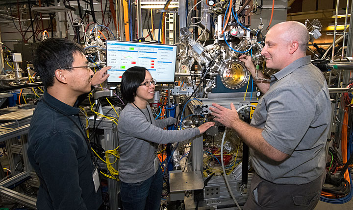 Brookhaven Lab scientists Mingyuan Ge, Iradwikanari Waluyo, and Adrian Hunt are pictured left to right at the IOS beamline, where they studied the growth pathway of an efficient catalyst for hydrogen fuel cells