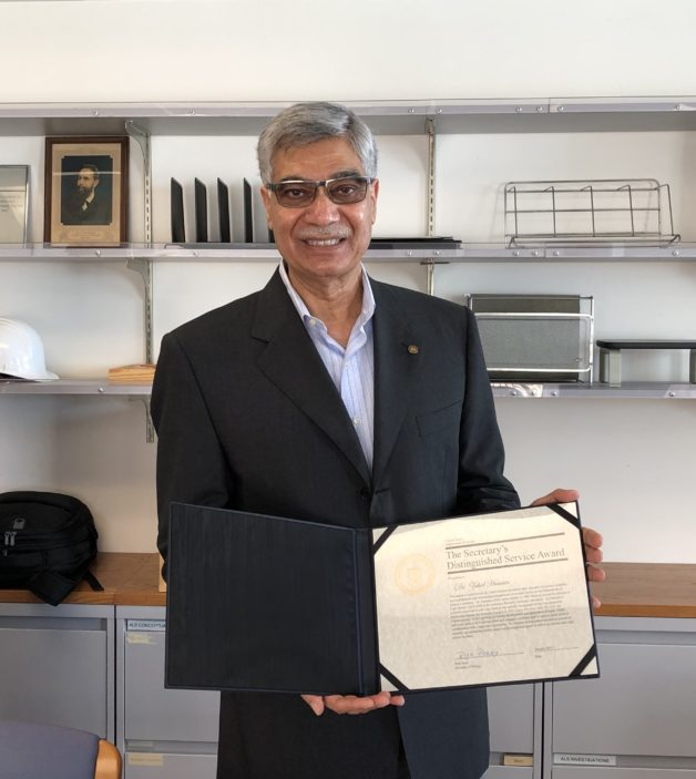 Zahid Hussain holds his DOE Secretary's Distinguished Service Award certificate. (Credit: Berkeley Lab)