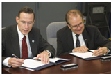 NOAA Administrator Conrad C. Lautenbacher, Jr. (left) and DOE Under Secretary for Science Dr. Raymond L. Orbach (right) at the signing of the MOU.