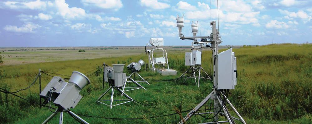 Three new scanning microwave radiometers (left) undergo testing in the instrument field at the Southern Great Plains site's Central Facility.