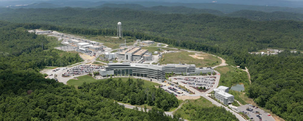 Aerial of the Spallation Neutron Source showing the Guest House, JINS, CLO, CNMS, and target building.